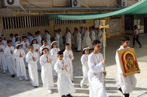 Irak,guerre,barbarie,enfants,première communion